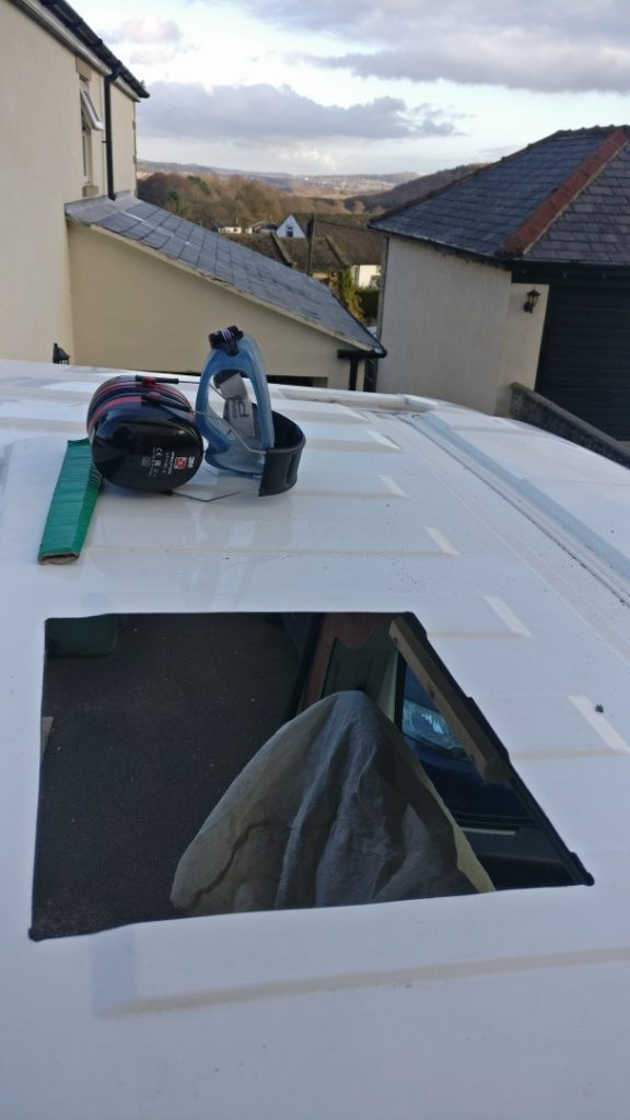 A hole cut in the roof of the van