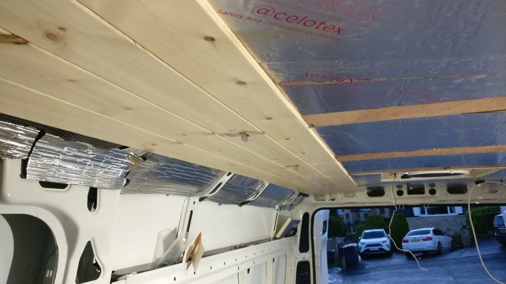 Pine cladding fitted to the ceiling, with celotex insulation also visible