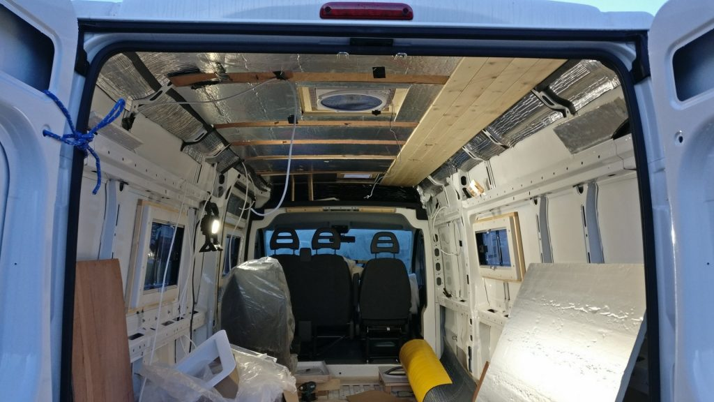 The van interior with partially fitted ceiling