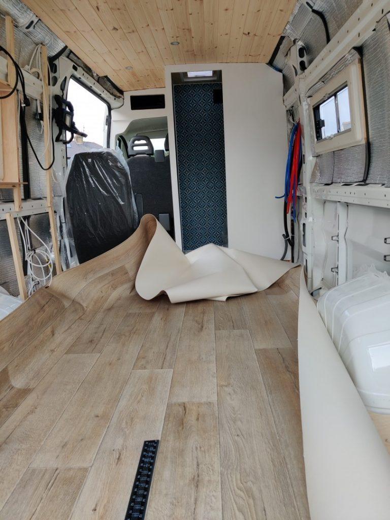 Vinyl floor covering laid loosely in the van